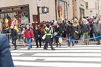 NYPD officers corral pedestrians for crowd control at intersections on Fifth Avenue in Midtown Manhattan in New York on Sunday, December 11, 2016. Only fourteen more days until Christmas.  (© Richard B. Levine)