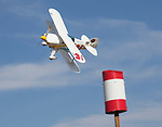 Tony Higa pilots Tango Tango in a Biplane heat race during the National Championship Air Races in Reno, Nevada on Thursday, September 14, 2017.