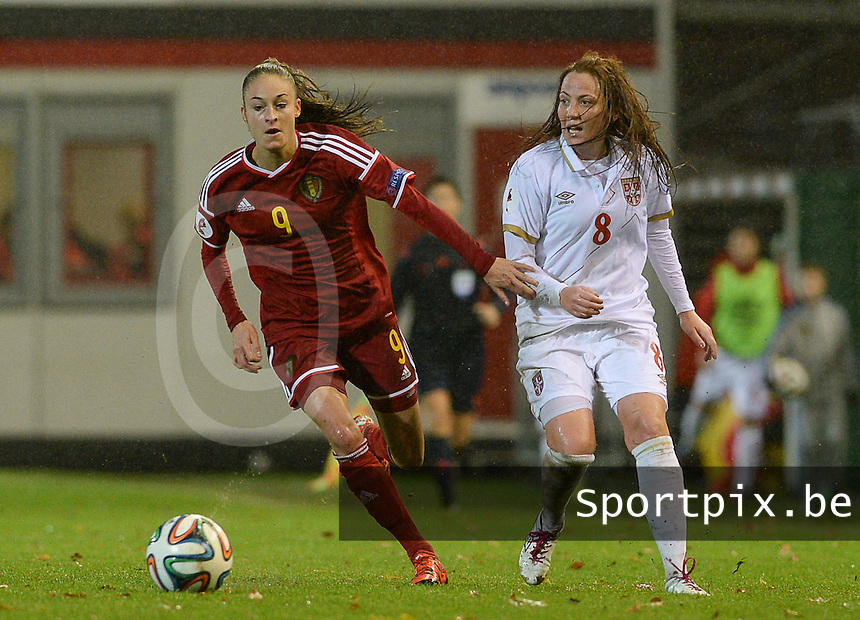 20151130 - LEUVEN ,  BELGIUM : Belgian Tessa Wullaert (left) pictured with Serbian Marija Ilic (r) during the female soccer game between the Belgian Red Flames and Serbia , the third game in the qualification for the European Championship in The Netherlands 2017  , Monday 30 November 2015 at Stadion Den Dreef  in Leuven , Belgium. PHOTO DAVID CATRY