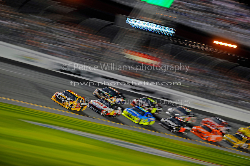 Jeff Burton (#31) leads the pack into the tri-oval.
