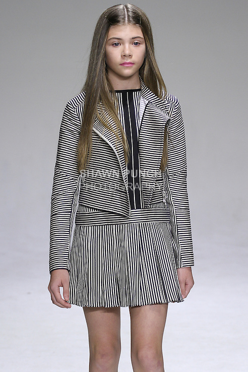 Model walks runway in an outfit from the Bonnie Young Spring 2015 collection, at petitePARADE Spring Summer 2015, during Kids Fashion Week in New York City, on October 19, 2014.