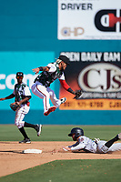 Lake Elsinore Storm shortstop Gabriel Arias (13) attempts to apply the tag to Alvaro Rubalcaba (12) on a stolen base attempt during a California League game against the Inland Empire 66ers on April 14, 2019 at The Diamond in Lake Elsinore, California. Lake Elsinore defeated Inland Empire 5-3. (Zachary Lucy/Four Seam Images)