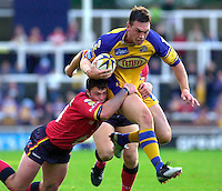 Pix:BEN DUFFY/SWpix.com...Super League Rugby League-Leeds Rhinos v London Broncos....25/07/2003...COPYRIGHT PICTURE>>SIMONWILKINSON>>01943 436649>>..Leed's Kevin Sinfield breaks past London's Neil Budworth