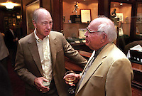 Former Green Bay Packers quarterback and coach Bart Starr and former sportswriter and Packers media representative Lee Remmel enjoy cocktails and conversation during the Lombardi players reunion at Lombardi's Steakhouse in Appleton, Wisconsin in September of 2001.