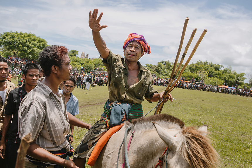 A senior Pasola warrior try to calm the crowds during a chaos in the event in Wainyaou, Kodi. Pasola is an ancient tradition from the Indonesian island of Sumba. Categorized as both extreme traditional sport and ritual, Pasola is an annual mock horse warfare performed in response to the harvesting season. In the battelfield, the Pasola warriors use blunt spears as their weapon. However, fatal accident still do occurs.