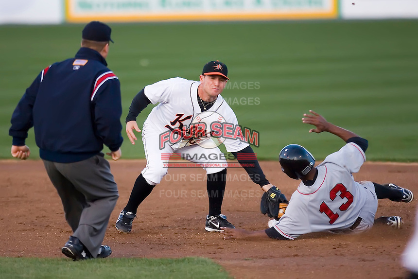 Shortstop Chris Amador (18) of the Frederick Keys tags out Cesar Quintero (13) of the Salem Avalanche as he tries to steal second base at Harry Grove Stadium in Frederick, MD, Tuesday, April 15, 2008.