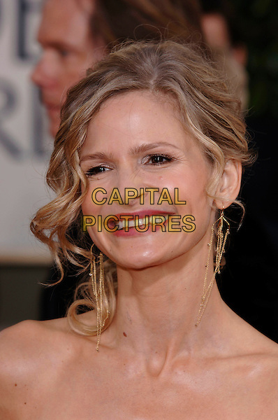 KYRA SEDGWICK.HFPA 63rd Golden Globe Awards at The Beverly Hills Hilton, Beverly Hills, California, USA..January 16th, 2006.Ref: PL .globes headshot portrait dangling gold earrings.www.capitalpictures.com.sales@capitalpictures.com.©Phil Loftus/Capital Pictures