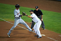 Peoria Javelinas first baseman D.J. Peterson (10) waits for a pickoff throw as JaCoby Jones (4) gets back to the bag with umpire Travis Eggert looking on during an Arizona Fall League game against the Scottsdale Scorpions on October 24, 2015 at Peoria Stadium in Peoria, Arizona.  Peoria defeated Scottsdale 3-1.  (Mike Janes/Four Seam Images)