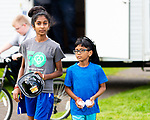 WATERBURY,  CT-051519JS11- Keeraan Rangasammy, 12, and her brother Lakeram Rangasammy, 9, make thier way through Waterville Park after visiting the Waterbury Fire Department's educational smoke house, during the Waterbury Police Community Outreach Program Wednesday at Waterville Park in Waterbury. The event was hosted by the Waterbury police department and town departments who were on hand to meet residents and offer assistance or answer any questions they may have. <br /> Jim Shannon Republican American