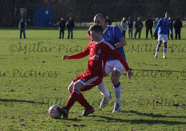 Cameron Smith lays the ball back under pressure from Kamil Witkorski in the Aberdeen v Rangers Clydesdale Bank Scottish Premier League U19 match played at Balgownie, Aberdeen on 24.2.12...