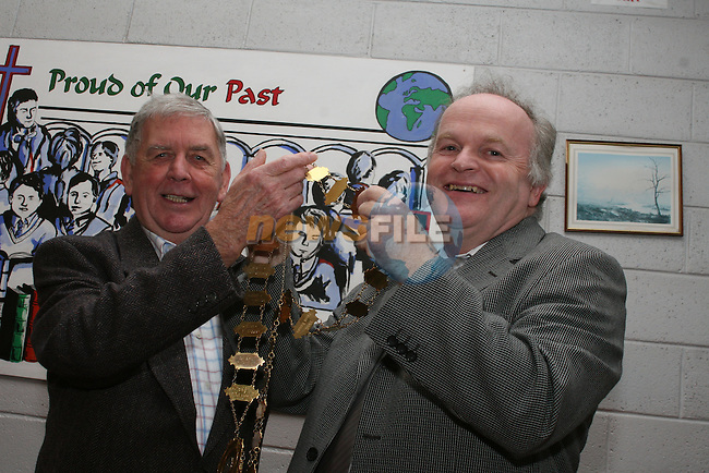 Past Pupils President Johnny Gregory passes the chains over to Seán Ó Briain at the Past Pupils AGM in St. Josephs CBS...Photo NEWSFILE/Jenny Matthews.(Photo credit should read Jenny Matthews/NEWSFILE)....This Picture has been sent you under the condtions enclosed by:.Newsfile Ltd..The Studio,.Millmount Abbey,.Drogheda,.Co Meath..Ireland..Tel: +353(0)41-9871240.Fax: +353(0)41-9871260.GSM: +353(0)86-2500958.email: pictures@newsfile.ie.www.newsfile.ie.FTP: 193.120.102.198.