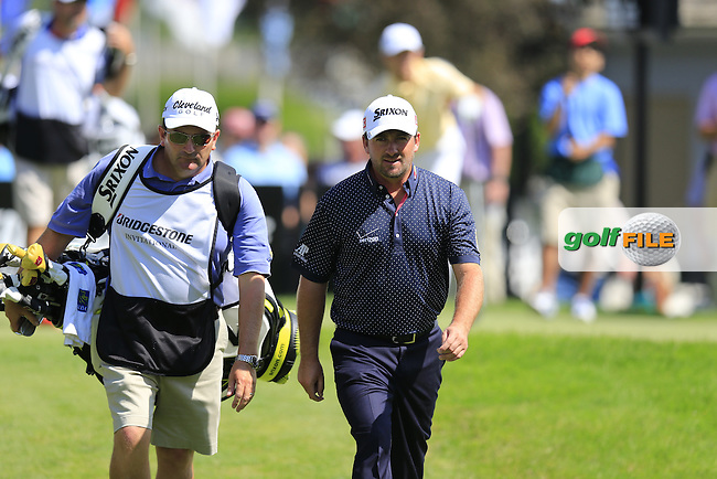 Graeme McDowell (NIR) and caddy Ken Comboy walk off the 17h tee during Thursday's Round 1 of the 2013 Bridgestone Invitational WGC tournament held at the Firestone Country Club, Akron, Ohio. 1st August 2013.<br /> Picture: Eoin Clarke www.golffile.ie