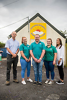 Friday  12 August 2016<br /> Pictured: Pat Faulkner (L) and Erin McGeough (R) with Emyr Beynon (C) and play workers Leah (2nd L) and Cari (4th L) <br /> Re: The Amazon team in Swansea has made a recent donation of £1,000 to Carmarthen Breakthro charity. The Amazon team are visited the charity to learn more about what they do and how they plan to use the money.