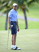United States President Barack Obama reacts to his short putt on the 18th hole as he and friends Marvin Nicholson, Bobby Titcomb,and Eric Whitaker enjoy a round of golf at Mid Pacific Country Club, Kailua, Hawaii on Monday, December 23, 2013.  The first family is enjoying holiday vacation in Hawaii until January 5, 2014. <br /> Credit: Cory Lum / Pool via CNP