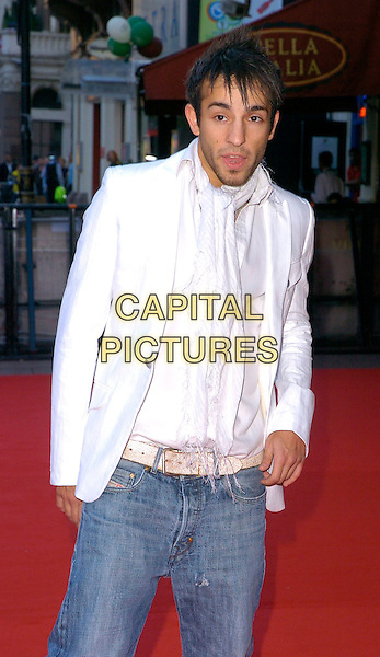 "SEZER YURTSEVEN.The ""Just My Luck"" UK premiere at Vue West End, London, UK..June 28th, 2006.Ref: CAN.half length jeans denim white jacket .www.capitalpictures.com.sales@capitalpictures.com.©Capital Pictures"
