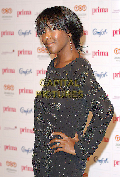 ANJELICA BELL.attending the Comfort Prima High Street Fashion Awards 2007, London, England,13th September 2007.half length Angelica Anjellica black dress hand on hip.CAP/ BEL.©Tom Belcher/Capital Pictures.