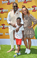 "LOS ANGELES, USA. August 10, 2019: Sterling K. Brown, Ryan Michelle Bathe & Son at the premiere of ""The Angry Birds Movie 2"" at the Regency Village Theatre.<br /> Picture: Paul Smith/Featureflash"