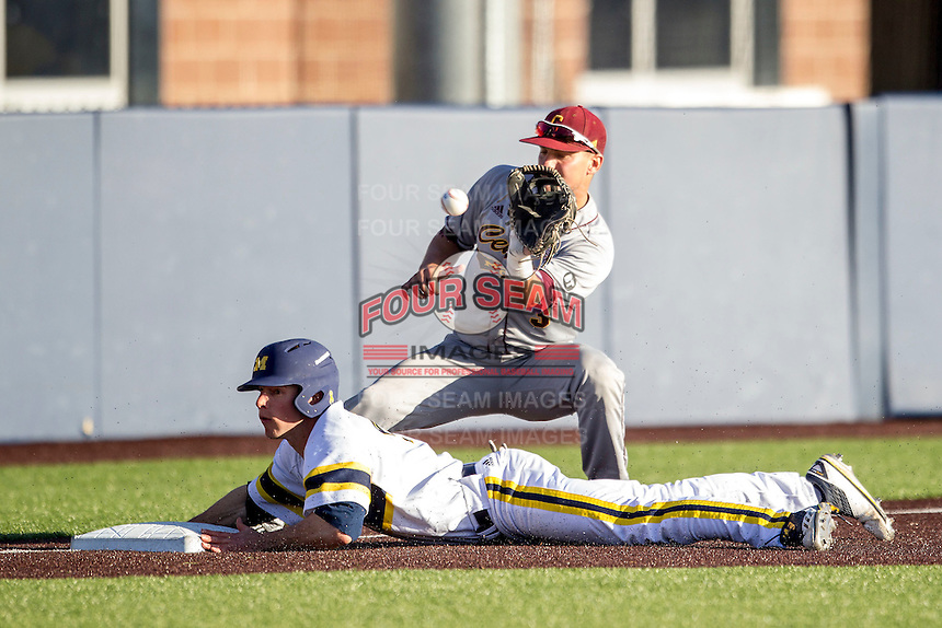 Michigan Wolverines outfielder Matt Ramsay (19) steals third base as Central Michigan Chippewas third baseman Joe Houlihan (3) waits for the throw on March 29, 2016 at Ray Fisher Stadium in Ann Arbor, Michigan. Michigan defeated Central Michigan 9-7. (Andrew Woolley/Four Seam Images)
