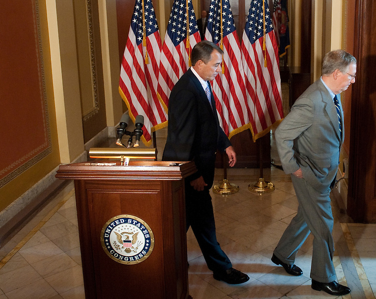 UNITED STATES - JULY 30: Speaker of the House John Boehner, R-Ohio, left, and Senate Minority Leader Mitch McConnell, R-Ky., hold a news conference in the Capitol to talk about the debt ceiling crisis on Saturday afternoon, July 30, 2011. (Photo By Bill Clark/Roll Call)
