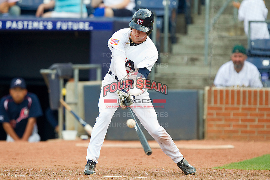 Tyler Naquin #33 (Texas A&M) of the USA Baseball Collegiate National Team strokes a pitch to left field against the Japan Collegiate National Team at the Durham Bulls Athletic Park on July 3, 2011 in Durham, North Carolina.  USA defeated Japan 7-6.  (Brian Westerholt / Four Seam Images)
