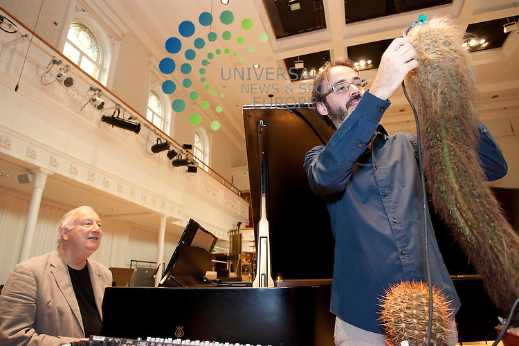 Conductor Ilan Volkov and pianist John Tilbury promote the BBC Scottish Symphony Orchestra gig marking 100 years since the birth of composer John Cage by demonstrating some of the unusual musical instruments being performed on Saturday 28 July - including an amplified cactus and a 'prepared' piano filled with nuts, bolts, balls and blutac. 26th July 2012. Picture: Jonathan Faulds / Universal News And Sport (Europe)
