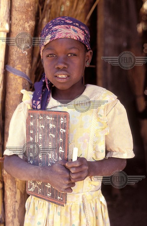 © Giacomo Pirozzi / Panos Pictures..CHAD..Girl learning the alphabet.