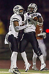 David Racine and Ron Dogan celebrate Dogan's rushing touchdown against Westwood Friday at Dragon Stadium.