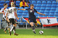 Abby Wambach takes a shot vs Germany in the 2010 Algarve Cup Final in Faro, Portugal. USA won 3-2.