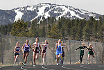 LEAD, S.D. -- MAY 4, 2013 -- Runners in the girls 4x100m relay make handoffs for the second leg with a snow-capped Terry Peak as a backdrop at the 2013 Mountain West Invitational T&F Meet Saturday at Mountain Top in Lead, S.D.  (Photo by Richard Carlson/dakotapress.org