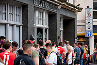 Pictured: Queues of people outside Elevens Bar in Cardiff, Wales, UK. Thursday 12 July 2018<br /> Re: Last night (Thurday 12 July) Elevens Bar &amp; Grill and the Football Association of Wales jointly hosted a Q&amp;A evening with Gareth Bale. At the event, Gareth unveiled a new piece of memorabilia for Elevens &ndash; his match worn boots from this year&rsquo;s Champions League Final with which he scored that incredible overhead kick.<br /> The event, hosted at Elevens Bar &amp; Grill was open to members of the public with doors opening at 6pm on Thursday evening. People started queueing from 3pm, with a cross-section of fans of all ages in Wales shirts and bucket hats. <br /> The Q&amp;A, conducted by Ian Gwyn Hughes from the FAW, discussed all aspects of his career so far, from growing up in Cardiff to winning 4 Champions League medals with Real Madrid. On growing up in Whitchurch, Gareth said: &ldquo;My family were a huge influence on me growing up. My parents were so supportive, taking me here there and everywhere so I could play football. Growing up I can hardly remember not being with a football &ndash; I even took one to bed!&rdquo;<br /> There were a lot of youngsters in the audience, eager to hear from their hero. Gareth&rsquo;s advice to them? &ldquo;Work hard for what you want and who knows where that could take you.&rdquo;<br /> As a left-footer, Ryan Giggs,  Wales&rsquo; national team manager was someone he looked up to growing up. Gareth mentioned it was great to beat Ian Rush&rsquo;s goal scoring record for Wales with his childhood idol as manager. &ldquo;I knew I&rsquo;d levelled his record at half time, I needed one more to break it. The manager wanted to take me off but I said give me another 15 minutes to see if I can do it. Luckily on 61 minutes our goalkeeping coach took too long to do the substitution on the paper, so it gave me an extra minute. It worked out perfectly.&rdquo;