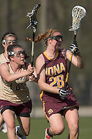 Elizabeth Coholan (I 28) advances the ball as Caroline Barclay (BC 18) defends. Boston College defeated Iona College, 19-5.