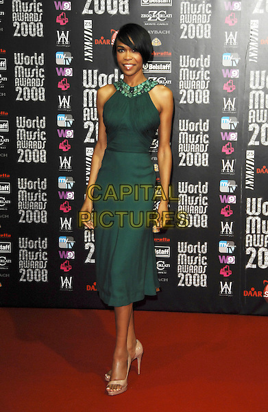 MICHELLE WILLIAMS .At the World Music Awards in Monte Carlo, Monaco, 9th November 2008..arrivals red carpet full length green dress skinny thin jewelled neckline beige heels shoes  .CAP/TTL .©TTL/Capital Pictures