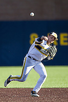 Michigan Wolverines third baseman Jake Bivens (18) makes an off balance throw to first base against the Central Michigan Chippewas on March 29, 2016 at Ray Fisher Stadium in Ann Arbor, Michigan. Michigan defeated Central Michigan 9-7. (Andrew Woolley/Four Seam Images)