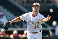 Texas Longhorns starting pitcher Dillon Peters #32 tosses the ball to first base against the Oklahoma Sooners in the NCAA baseball game on April 6, 2013 at UFCU DischFalk Field in Austin, Texas. The Longhorns defeated the rival Sooners 1-0. (Andrew Woolley/Four Seam Images).