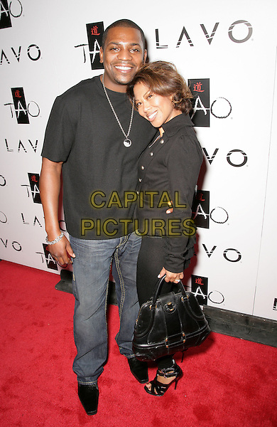 MEKHI PHEFIER & ONI SOURATHA .Tao Asian Bistro and Nightclub Celebrates its 4th Anniversary at the Venetian Resort Hotel and Casino, Las Vegas, Nevada, USA, 3rd October 2009..full length black t-shirt jeans bag .CAP/ADM/MJT.©MJT/Admedia/Capital Pictures