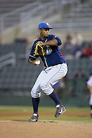 Asheville Tourists relief pitcher Juan Pena (31) in action against the Kannapolis Intimidators at Intimidators Stadium on May 28, 2016 in Kannapolis, North Carolina.  The Intimidators defeated the Tourists 5-4 in 10 innings.  (Brian Westerholt/Four Seam Images)