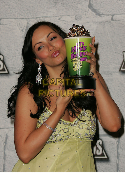 MARTINE McCUTCHEON.Attends the 2004 Mtv Movie Awards held at The Sony Picture Studios in Culver City, California  .June 6, 2004.half length, half-length, trophy, silver dangling earrings, kissing, puckering, gesture.www.capitalpictures.com.sales@capitalpictures.com.©Capital Pictures