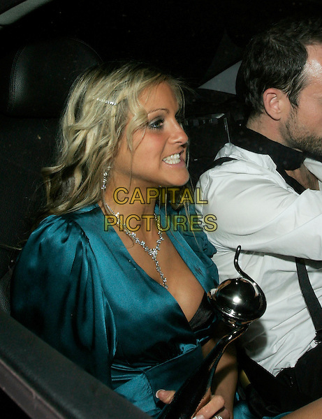 NIKKI GRAHAM - BIG BROTHER.Leaving The National Television Awards 2006 held at the Royal Albert Hall, London, UK. .October 31st, 2006.Ref: AH.half length award trophy car blue dress funny face.www.capitalpictures.com.sales@capitalpictures.com.©Adam Houghton/Capital Pictures.