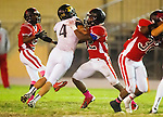 Inglewood, CA 10/09/14 - Michael Joncich (Peninsula #4) and Christian Williams (Morningside #22) in action during the Palos Verdes Peninsula vs Morningside CIF Varsity football game at Coleman Field in Inglewood.  Peninsula defeated Morningside 24-13.