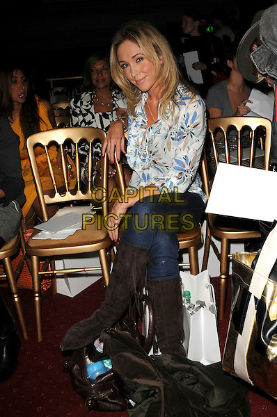 JENNY FROST.Spotted during London Fashion Week, London, England..September 15th, 2008.LFW full length jeans denim blue white print shirt legs crossed sitting brown boots tucked in .CAP/CAS.©Bob Cass/Capital Pictures.