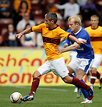 Keith Lasley shadowed by Steven Naismith