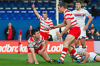 Picture by Allan McKenzie/SWpix.com - 17/04/2015 - Rugby League - Ladbrokes Challenge Cup - Wakefield Trinity Wildcats v Halifax RLFC - Rapid Solicitors Stadium, Wakefield, England - Halifax's James Saltonstall is congratulated on scoring against Wakefield.