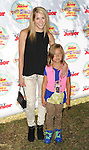 Allison Holker and daughter arriving at Pirate and Princess: Power Of Doing Good, held at Brookside Park Pasadena, Ca. on August 16, 2014.