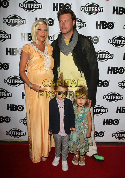"Tori Spelling, Dean McDermott with their Son Liam and Daughter Stella.2011 Outfest Screening Of ""Hoarders: Untold sTORI""  Held At The John Anson Ford Amphitheatre, Hollywood, California, USA, 16th July 2011..full length orange peach long maxi dress family husband wife married couple pregnant kids children  leather black jacket grey gray scarf .CAP/ADM/KB.©Kevan Brooks/AdMedia/Capital Pictures."
