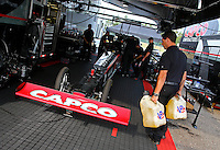 Aug. 18, 2013; Brainerd, MN, USA: Crew members with NHRA top fuel dragster driver Steve Torrence warming up in the pits during the Lucas Oil Nationals at Brainerd International Raceway. Mandatory Credit: Mark J. Rebilas-