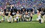 Several University of Notre Dame players pause for a few moments before their game against the University of Utah at Notre Dame Stadium in South Bend, IN on November 13, 2010. (Photo by Bob Campbell)