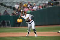 OAKLAND, CA - APRIL 4:  Chad Pinder #18 of the Oakland Athletics bats against the Boston Red Sox during the game at the Oakland Coliseum on Thursday, April 4, 2019 in Oakland, California. (Photo by Brad Mangin)