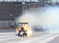 Oct 29, 2017; Las Vegas, NV, USA; NHRA top fuel driver Steve Torrence explodes an engine on fire during the Toyota National at The Strip at Las Vegas Motor Speedway. Mandatory Credit: Mark J. Rebilas-USA TODAY Sports