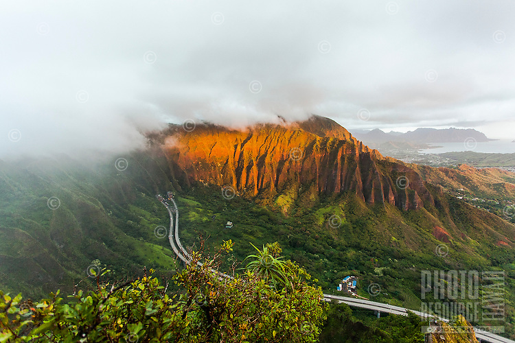 "An aerial view at dawn of the Ko'olau mountain range and the H-3 Freeway in Haiku valley from the Haiku Stairs (""Stairway to Heaven"") hiking trail in Kaneohe, O'ahu"
