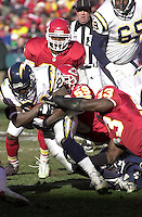 San Diego Chargers running back La Dainian Tomlinson found the Chiefs ganging up on him as he was tackled by Donnie Edwards and Marvcus Patton in the second half at Arrowhead Stadium in Kansas City, Missouri on December 23,2001.  Kansas City won 20-17.